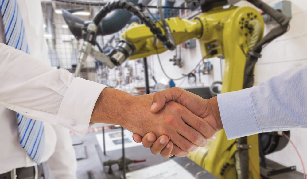 Close-up shot of a handshake in office against garage